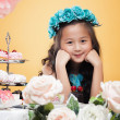 Dreamy little girl posing with flowers, close-up — Stock Photo