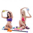 Two smiling young female athletes posing in studio — Stock Photo #39090739