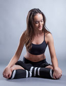 Sporty brunette posing in lotus position, close-up — Photo