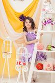 Elegantly dressed girl posing in vintage interior — Stock Photo