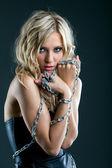 Studio shot of seductive girl posing with chain — Stock Photo