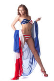 Leggy model posing in bikini with american flag — Stock Photo