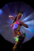 Excited naked woman posing with colorful UV makeup — Stock Photo