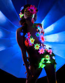 Mystery woman with bright glowing pattern on body — Stock Photo