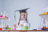Curious schoolgirl conducting experiment in lab — Stock Photo