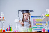Portrait of smiling little scientist in laboratory — Stock Photo