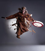 Studio shot of angry shaman posing in jump — Stok fotoğraf