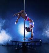 Image of flexible skinny girl dancing on pole — Stock Photo