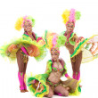 Energetic young girls dancing in carnival costumes — Stock Photo #42210419