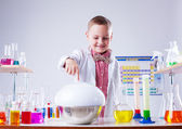 Adorable little boy watching reaction of reagent — Stock Photo