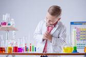 Image of little scientist posing with reagents — Stock Photo