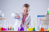 Inquisitive naturalist mixes reagents in flask — Stock Photo