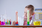 Attentive scientist watching chemical reaction — Stock Photo