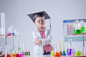 Funny boy posing as chemist in chemical laboratory — Stock Photo