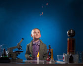 Curious experimenter watching flying fire in lab — Photo