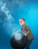 Adorable boy posing in cloud of steam, close-up — Стоковое фото