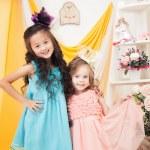 Cheerful elegant girlfriends posing at celebration — Stock Photo