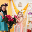 Pretty little girls posing with bouquet of peonies — Stock Photo