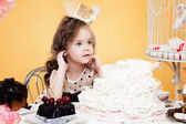 Fascinating little lady posing with tasty treats — Stock Photo