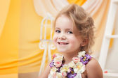 Portrait of cute little girl smiling at camera — Stock Photo