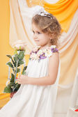 Image of fascinating little girl posing with rose — Stock Photo