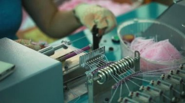 View of knitter working on machine — Stock Video