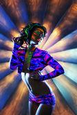 Showy heavily made girl dancing in nightclub — Stock Photo