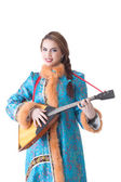 Charming Russian girl playing balalaika in studio — Stock Photo