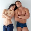 Image of scantily clad couple posing at camera — Stock Photo #44680065