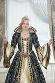 Image of unsmiling woman in luxurious royal dress — Stock Photo