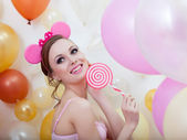 Image of smiling comely girl posing with lollipop — Stock Photo