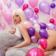 Flirty nude blonde lying on big teddy bear — Stock Photo