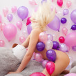 Nude blonde posing with balloons and teddy bear — Stock Photo #46406809
