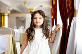 Beautiful little fashionista posing in restaurant — Stock Photo