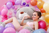 Smiling beautiful model posing with plush bear — Stock Photo