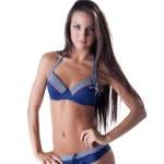 Portrait of long-haired brunette in blue bikini — Stock Photo #46536881