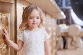 Portrait of elegant little girl posing at camera — Stock Photo