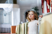 Portrait of smart little girl posing in restaurant — Stock Photo