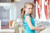 Beautiful curly girl posing in elegant blue dress — Stockfoto