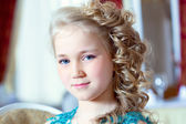 Portrait of little blue-eyed girl with ringlets — Stock Photo