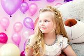Smiling pretty blonde girl posing in playroom — Stock Photo