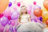 Lovely young lady posing with colorful balloons — Stock Photo