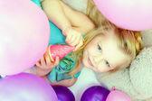 Smiling cute young girl posing at camera, close-up — Stock Photo