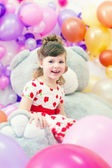 Image of merry little girl posing in playroom — Stockfoto