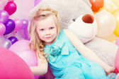Serious blue-eyed little girl posing at camera — Stock fotografie