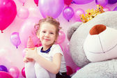 Smiling girl posing with ice cream in playroom — Stock Photo