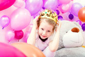 Portrait of funny little girl trying on crown — Stock Photo