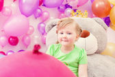 Amusing blonde girl posing in playroom — Stock Photo
