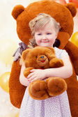 Charming little girl hugging favorite toy — Stock Photo