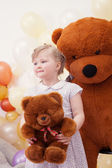 Funny blonde girl posing with teddy bears — Stock Photo